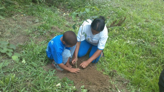 Mother and Child plant a tree in Cunha
